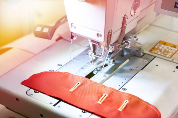 Sewing machine with red cloth stock photo