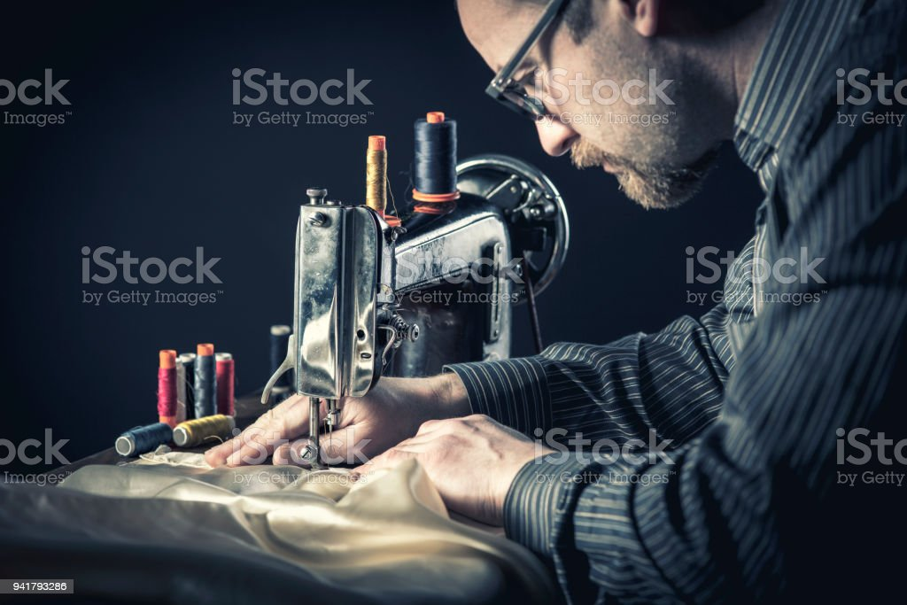 sewing machine worker stock photo