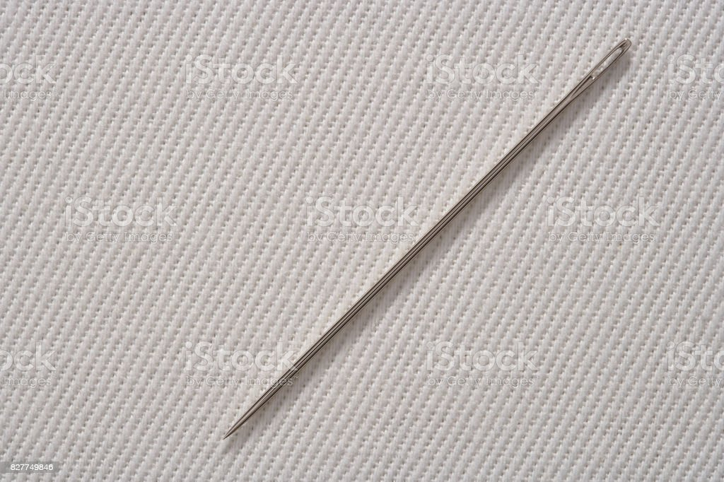 Sewing Needle On Cotton Fabric Background With Real Shadow Stock