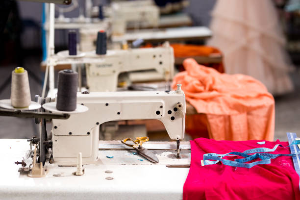 Sewing or tailoring industrial hall with machinery stock photo