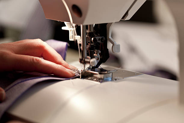 sewing - sewing machine needle stock photos and pictures