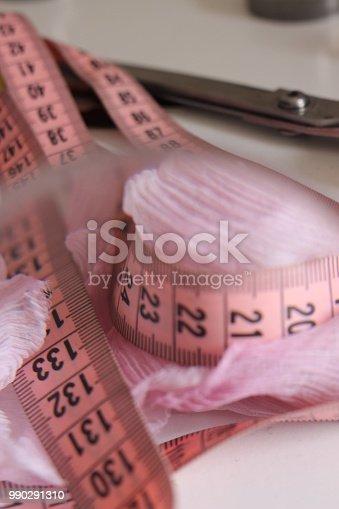 istock Sewing pink meter 990291310
