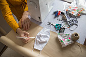 Woman is sewing protective masks