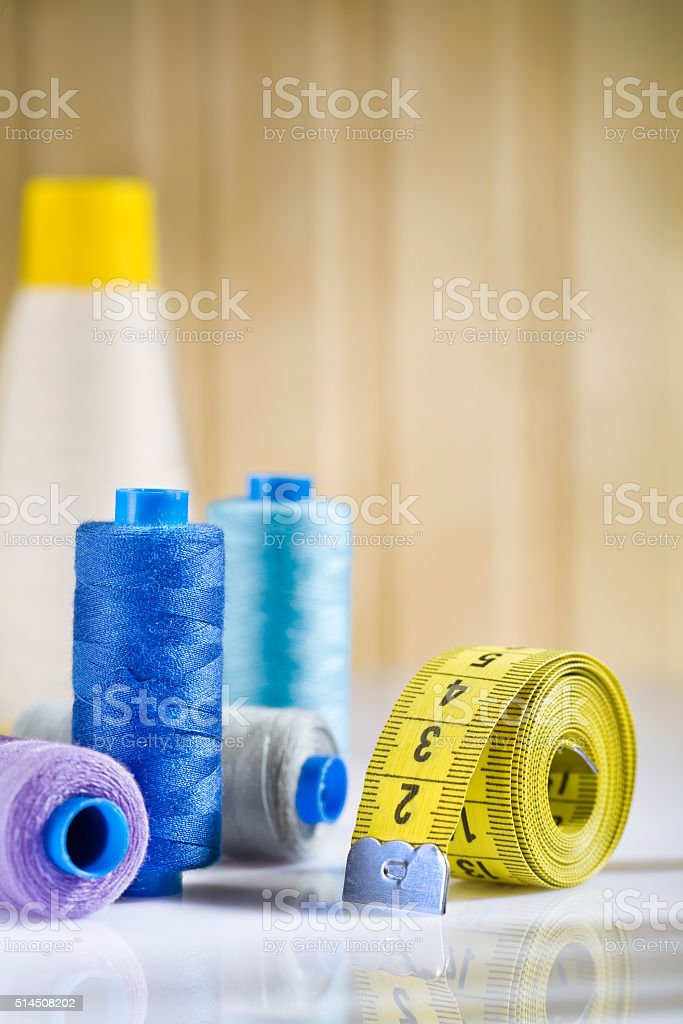 sewing spools and tapeline stock photo