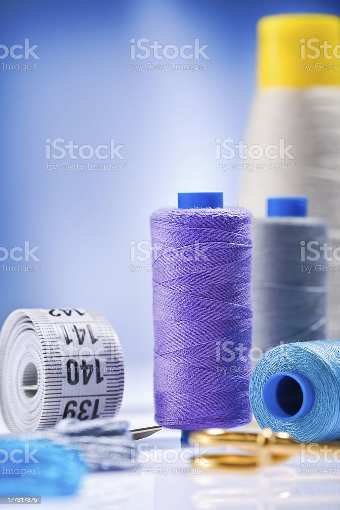 sewing spools with threads and other items stock photo