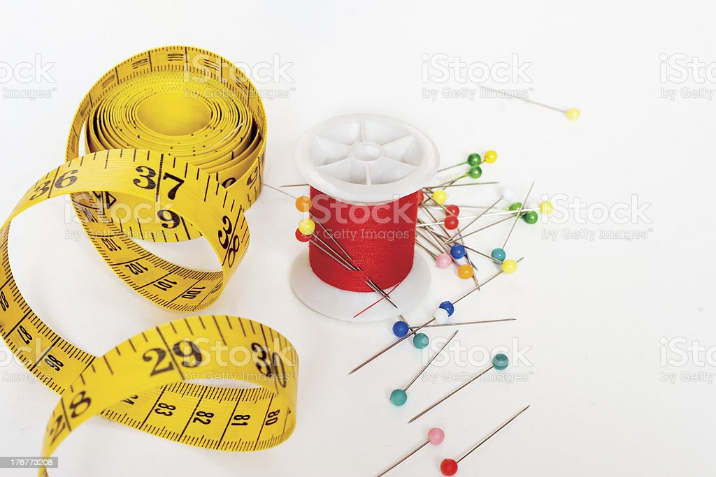 sewing supplies: pins, thread, tape royalty-free stock photo