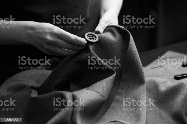 Sewing the buttons to the jacket picture id1038042012?b=1&k=6&m=1038042012&s=612x612&h=fmjp1qpvc8tdxb23sjtmpxvwqrjnntgmdjjnn04jete=