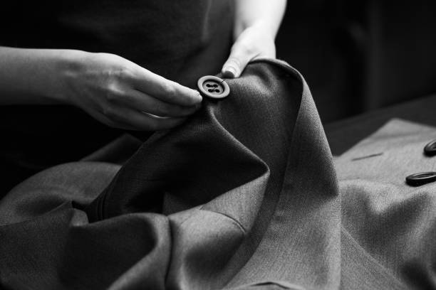 sewing the buttons to the jacket - customize stock pictures, royalty-free photos & images