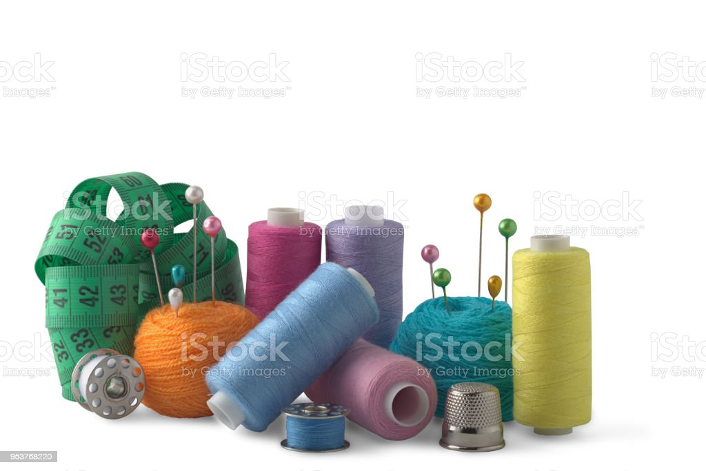 sewing thread on bobbins red yellow green on white background for designers stock photo