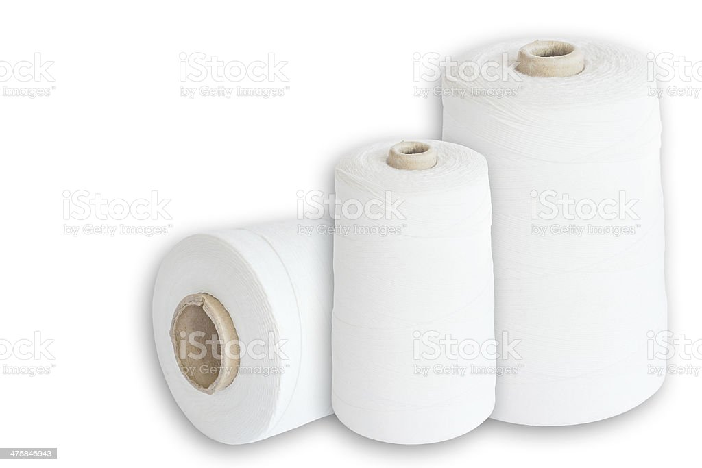 Sewing thread spools, natural fiber, elevated view stock photo