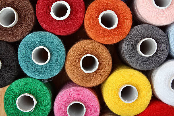 sewing threads multicolored - embroidery machine stock pictures, royalty-free photos & images