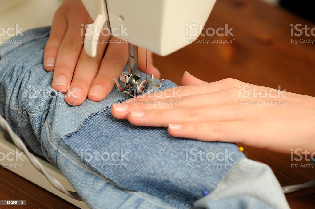 Sewing trousers on the machine royalty-free stock photo
