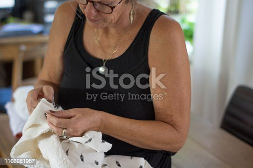 Woman sewing for the coming baby