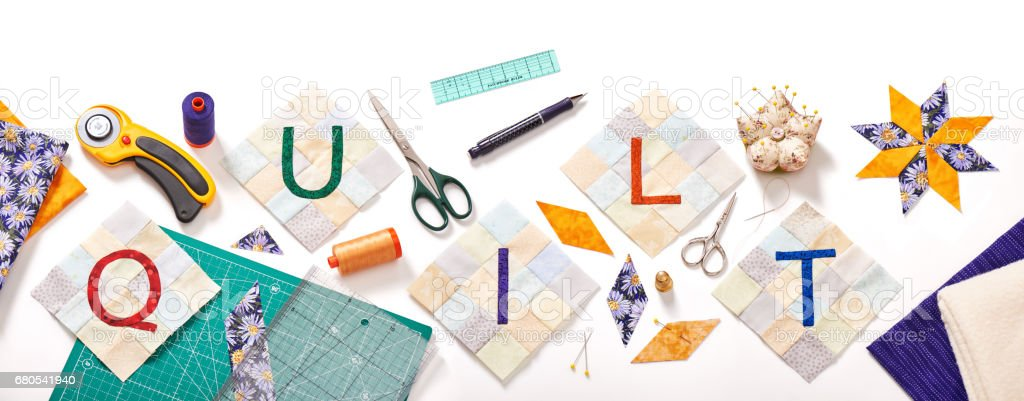 sewn letters, consisting to the word quilt surrounded by accessories for patchwork stock photo