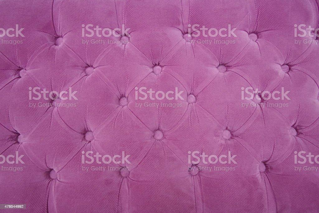 Sewn purple cloth background stock photo