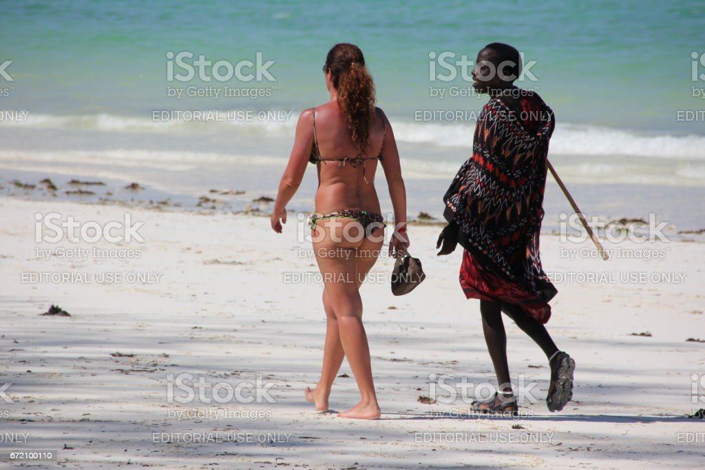 Sex On The Beach Maasai Man Walking With European Lady At The Kiwengwa Beach Zanzibar Indian Ocean Africa Stock Image