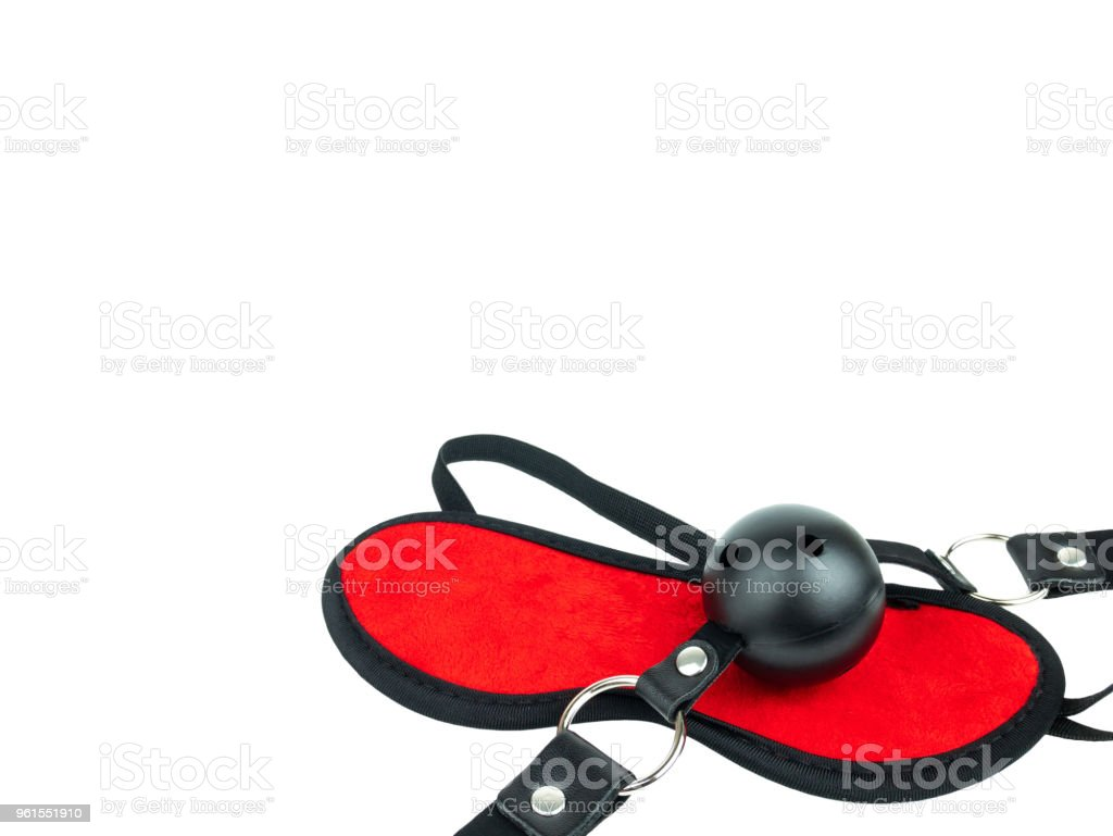 Sex toy black leather latex strap with red ball and eye mask, BDSM Sex attributes, Sadism Masochism Bondage Discipline Belting. isolated on white, Clipping path stock photo