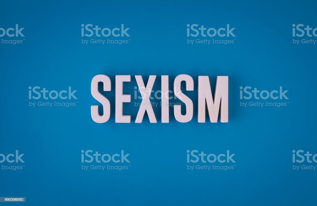 Sexism lettering sign stock photo
