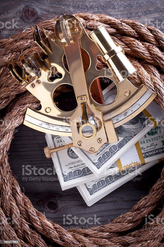 Sextant and Money stock photo