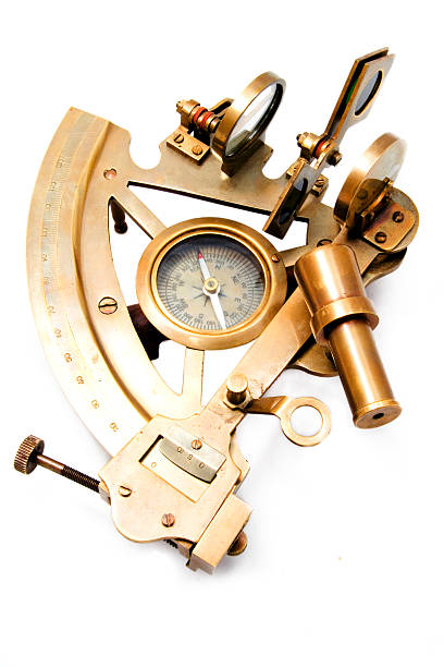 a sextant isolated on white background - vintage nautical stock photos and pictures
