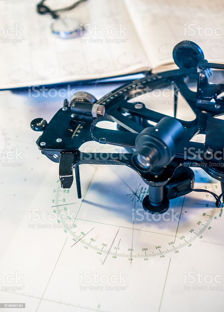 Sextant on map stock photo