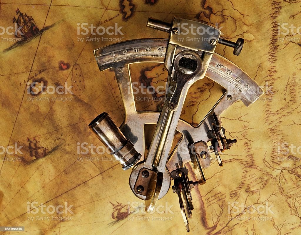 Sextant on the old map stock photo