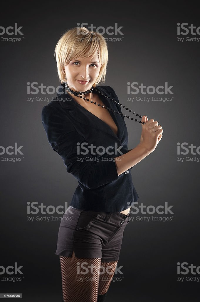 sexual blond woman in short skirt . royalty free stockfoto