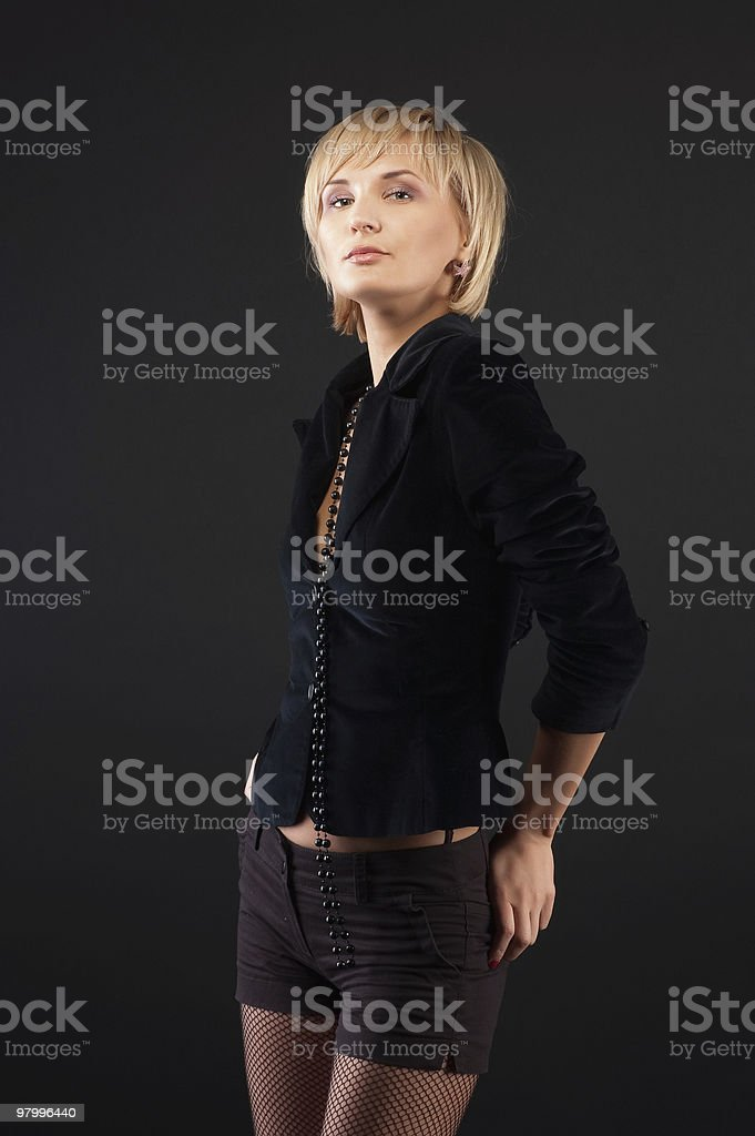 sexual blond woman in short skirt . royalty-free stock photo
