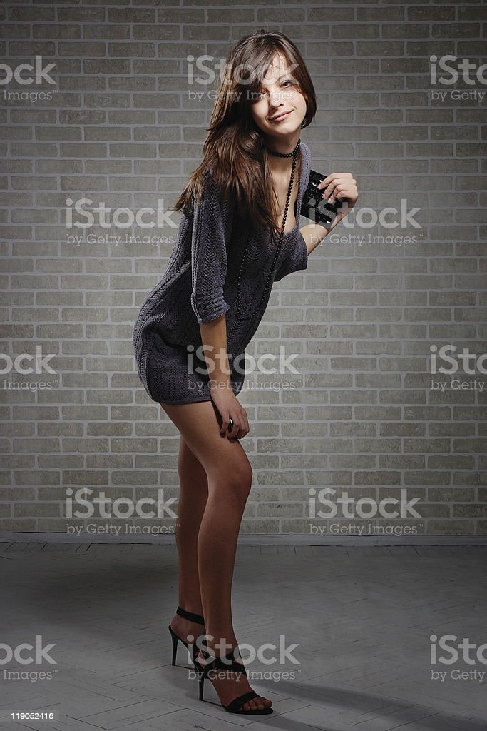 Sexual brunette fashion model  in knitted dress royalty-free stock photo
