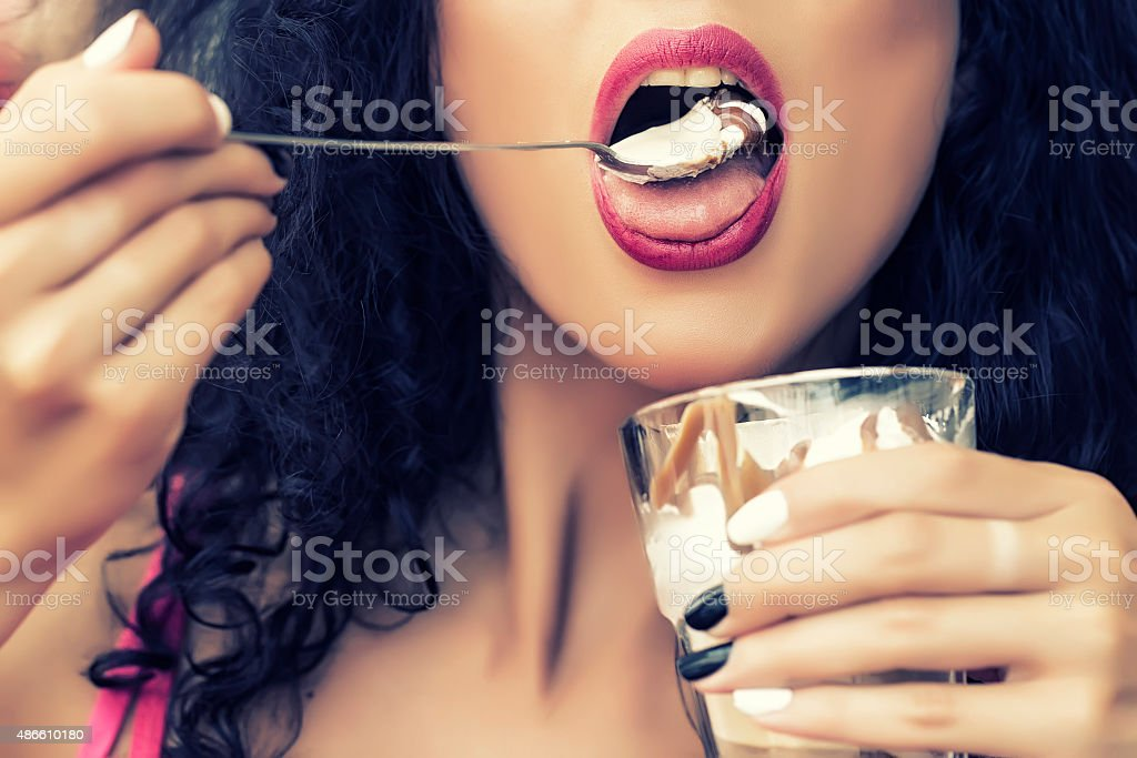 Sexual female lips with dessert stock photo