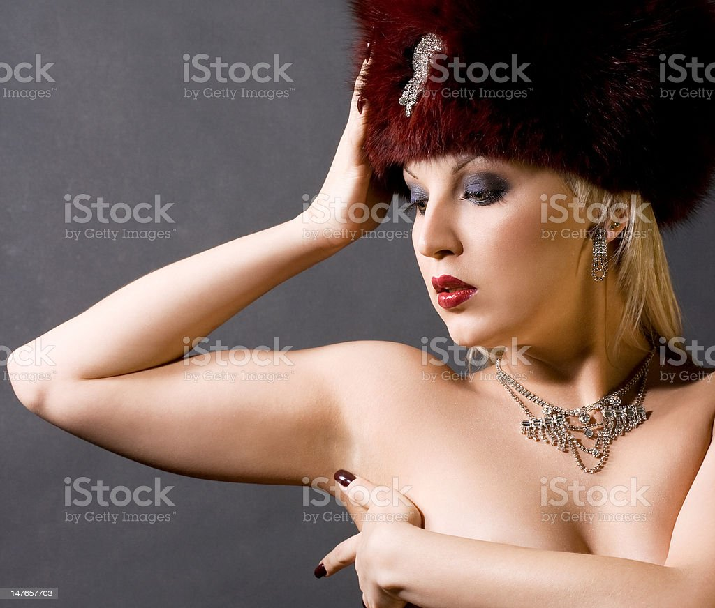 sexual girl in a red fur cap royalty-free stock photo