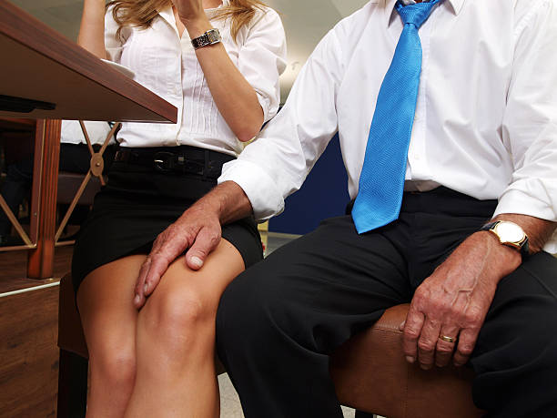 sexual harassment at work - human knee stock photos and pictures