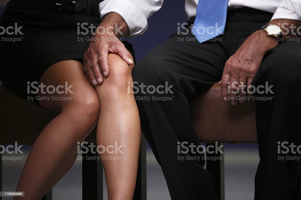 Sexual harassment at work stock photo