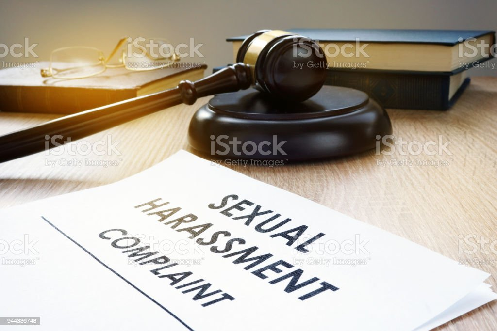 Sexual harassment complaint and gavel on a desk. - foto stock
