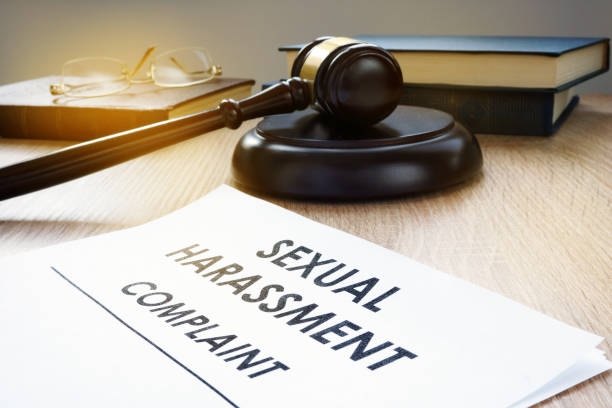 Sexual harassment complaint and gavel on a desk. Sexual harassment complaint and gavel on a desk. harassment stock pictures, royalty-free photos & images