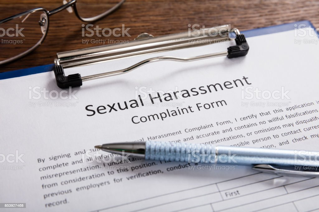 Sexual Harassment Complaint Form With Pen stock photo
