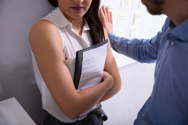 Sexual Harassment In Office Close-up Of A Man Trying To Harassed The Businesswoman Holding Document harassment stock pictures, royalty-free photos & images