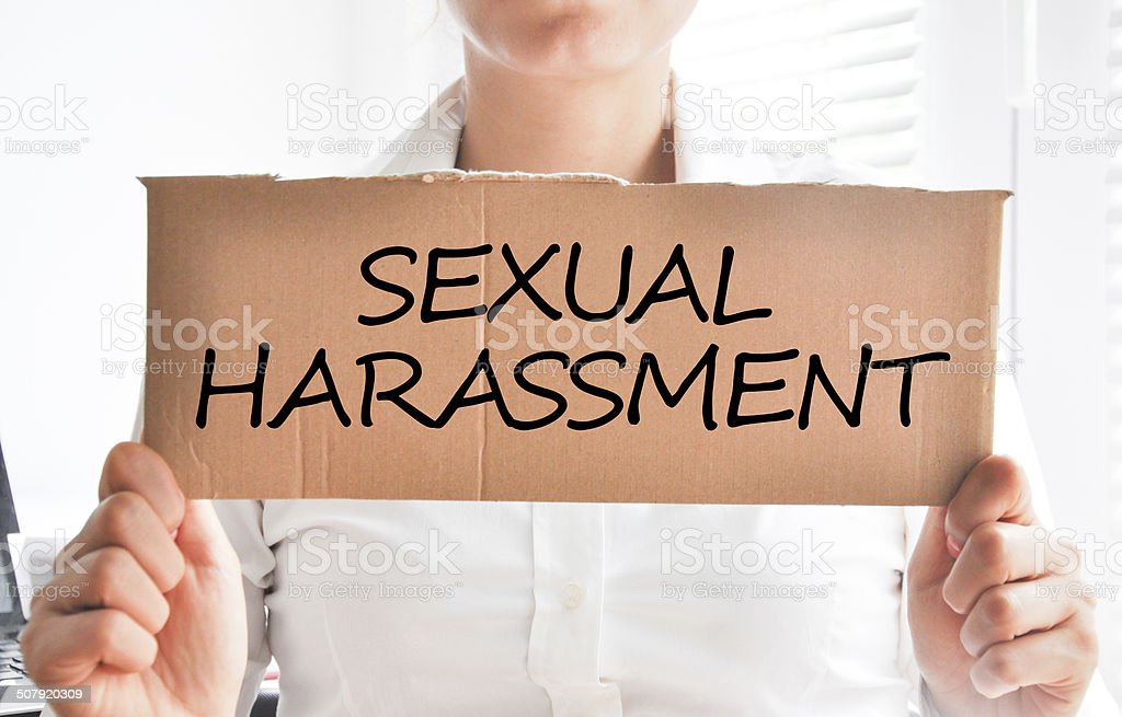 Sexual harassment text on cardboard stock photo