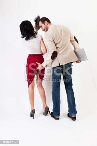 istock Sexual harassment. Woman hitting the aggresor  with her agenda 168447178