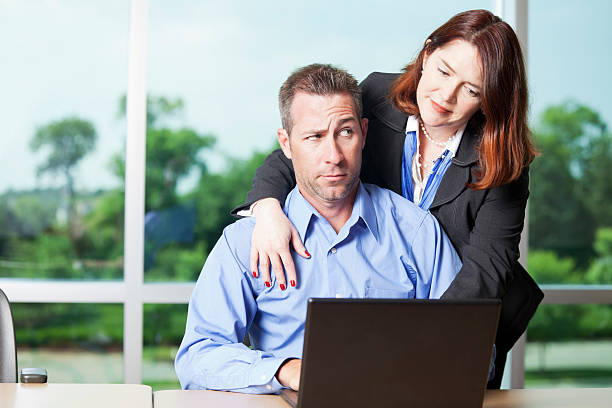 Sexual harrassment in the workplace Female boss making unwanted advances towards a male employee. You might also be interested in this: shock tactics stock pictures, royalty-free photos & images