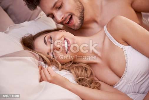 istock Sexual scene of passionate young couple in the bedroom 486711638
