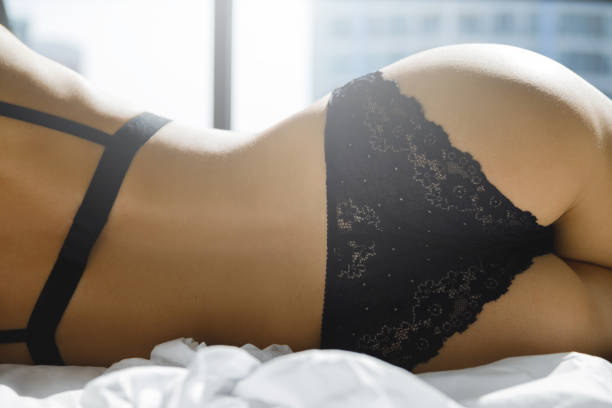 Sexual shapes of female body Sexy woman lying on the bed. Sexual shapes of female body hot sexy butts stock pictures, royalty-free photos & images