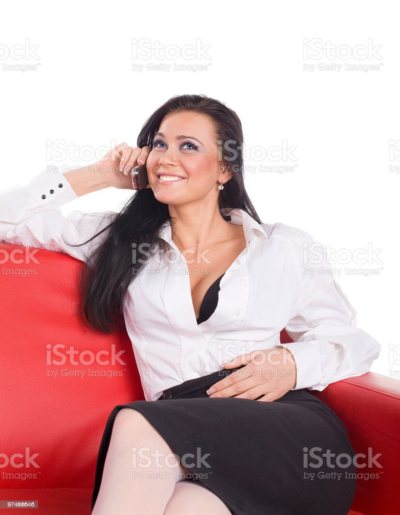 sexual woman call phone and smile on red sofa royalty-free stock photo