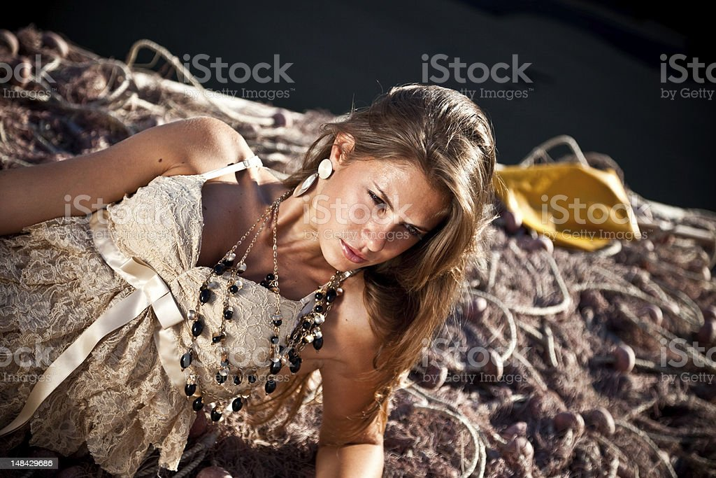 Sexy 20s Girl Sitting On Fishing Net royalty-free stock photo