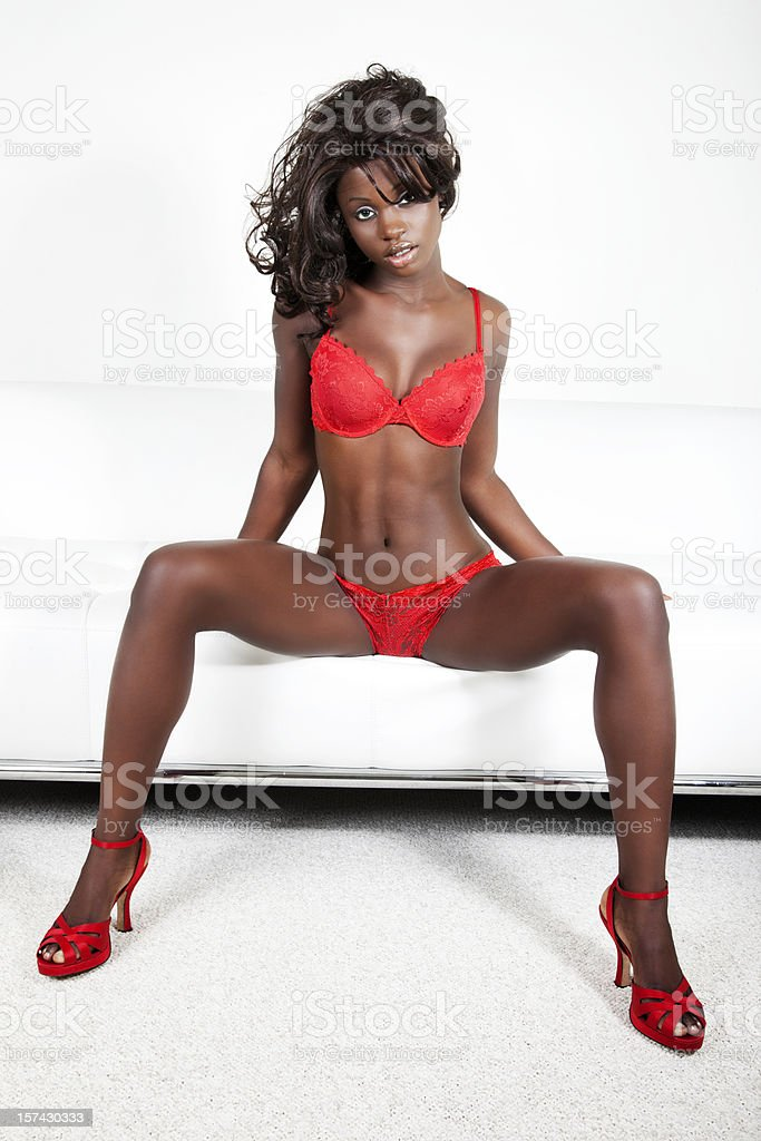 Sexy African American Fashion Model on White Leather Sofa stock photo