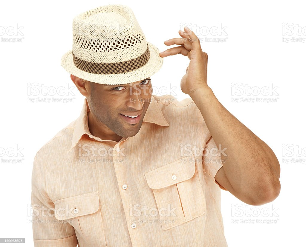 Sexy African American man showing off wearing a summer hat stock photo