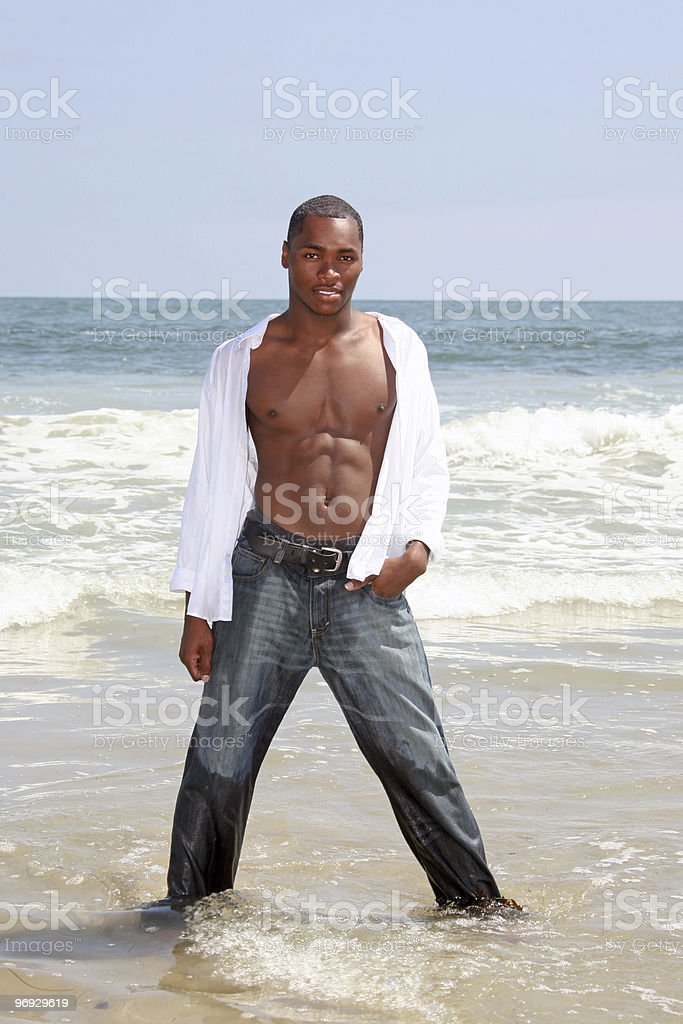 Sexy African American Man Standing in the Surf royalty-free stock photo