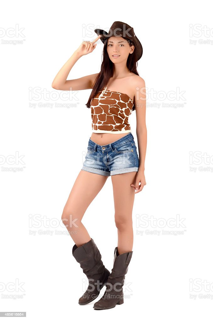 Sexy american cowgirl with jeans shorts and a cowboy hat. - Stock image . dcf6a9ccea1