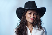 istock A sexy and beautiful cowgirl wearing a hat  464702890