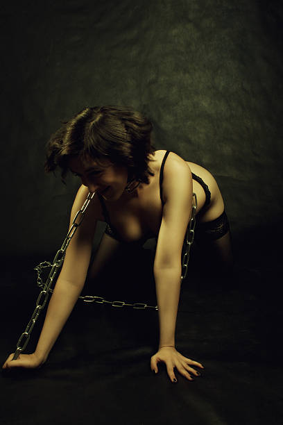 sexy and chained - debauch stock pictures, royalty-free photos & images